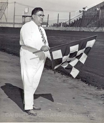 Bill_mitchell_w_checkered_flag_mcs